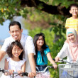 Stock Photo: Happy family with bikes