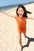 Girl running in the beach — Stock Photo