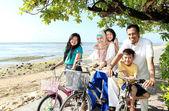 Happy family with bikes — Stock Photo