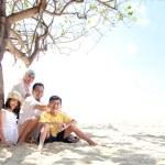 Happy family at the beach — Stock Photo #12692212