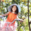 Girl riding bicycle outdoor — Stock Photo #12692041