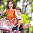 Kids riding bike together — Stockfoto