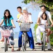 Happy family with kids riding bikes — Stock Photo
