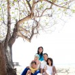 Asian family at the beach — Stock Photo