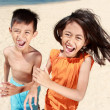 Stock Photo: Kids running in the beach