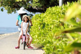 Girl riding bike outdoor — Stock Photo