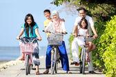 Happy family with kids riding bikes — Stock Photo
