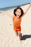 Girl running in the beach — Stock Photo