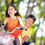 Kids riding bike together — Stock Photo #13925997
