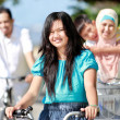Happy family with bikes — Stock Photo #13925941