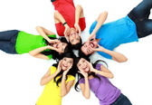 Colorful group of friends on the floor — Stock Photo