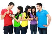 Young teenager using handphone — Stock Photo