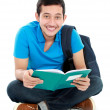 Stock Photo: College student reading a book