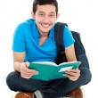 College student reading a book - Stock Photo