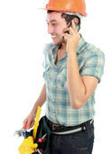 Happy worker using mobile phone — Stock Photo
