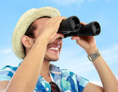 Traveler using binnocular — Stock Photo