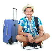 Happy tourist sitting on the floor — Stock Photo