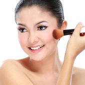 Woman with a make-up brush — Stock Photo