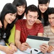 amistoso grupo de estudiantes con tablet pc — Foto de Stock   #14498969