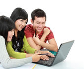 Group of young student with laptop — Stock Photo