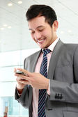Businessman texting a message — Stock Photo
