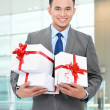 Businessman with gift boxes — Stock Photo