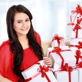 Woman with many gift box in the couch — Stock Photo