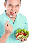 Man eating salad — Stock Photo