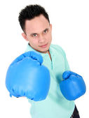 Young man with boxing glove — Stock Photo