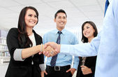 Business team shaking hands — Stock Photo