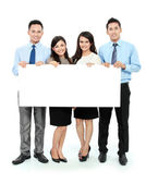 Business team with big blank card — Stock Photo