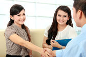 Business colleagues shaking hands after interview — Stock Photo