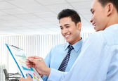 Businessmen discussing a business chart growth — Stock Photo