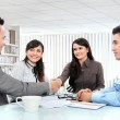 Stock Photo: Business team making a deal
