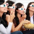 Happy friends watching movie together — Stock Photo