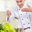 Professional male chef cooking — Stock Photo