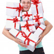 Man carrying many gift boxes — Stock Photo
