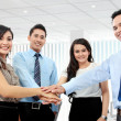 Business team with their hands together — Stock Photo #19848333