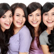 Foto Stock: Group of beautiful women smiling