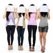 Group of beautiful women with blank paper — Stock Photo #19848931