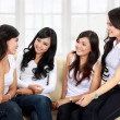 Four women friends talking — Stok fotoğraf