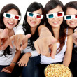 Woman pointing to TV while watching 3d movie — Stok fotoğraf