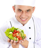 Chef with healthy food — Stock Photo