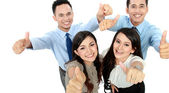 Excited team showing thumbs up — Stock Photo