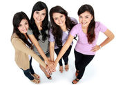 Group of beautiful women with their hands together — Stock Photo