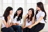 Four women friends talking — Stock Photo
