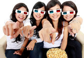Woman pointing to TV while watching 3d movie — Stock Photo
