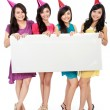 Four beautiful girl holding blank board — Stock Photo