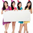 Stock Photo: Four beautiful girl holding blank board