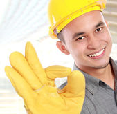 Smiling young worker — Stock Photo